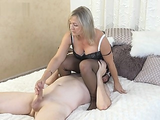 Ala gets on top of slave and gives foot job and facesits wearing nylons. milf