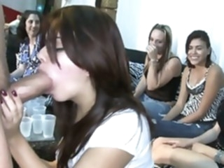 Redhead girls giving head in a club blowjob