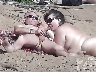 Blowjob on a nudist beach. amateur